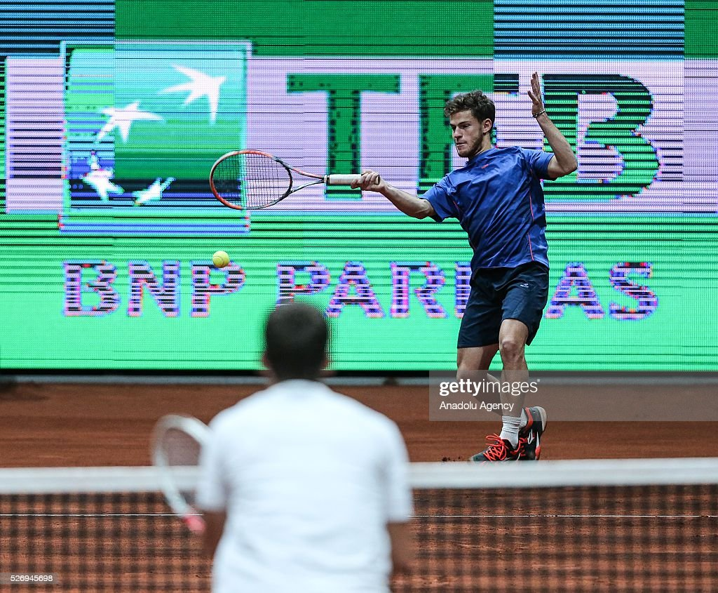 Diego Schwartzan (rear) of Argentina in action against Dudi Sela (L) of Israel during the men's double match at the TEB BNP Paribas Istanbul Open tennis tournament at Koza World of Sports Arena in Istanbul, Turkey on May 01, 2016.