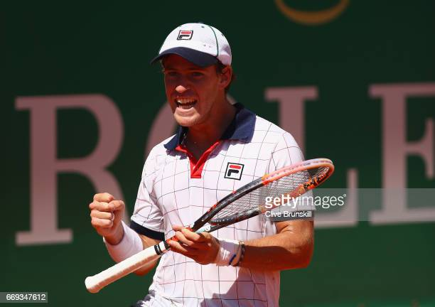 Diego Schwartzman of Agentina celebrates match point against Bernard Tomic of Australia after his straight sets victory in his first round match on...