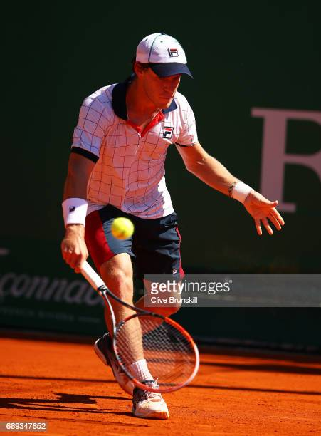 Diego Schwartzman of Agentina plays a backhand against Bernard Tomic of Australia during his straight sets victory in his first round match on day...