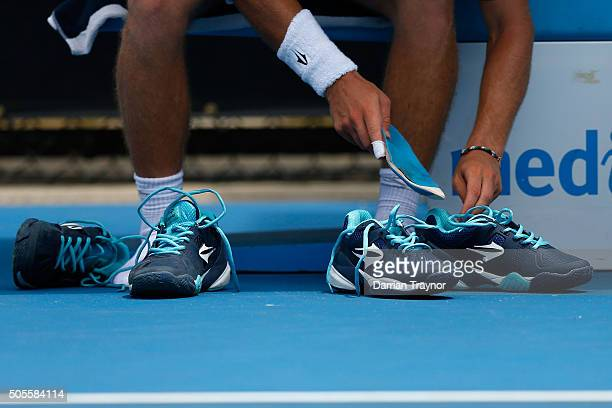 Diego Schwartzman of Argentina changes his shoes in his first round match against John Millman of Australia during day two of the 2016 Australian...
