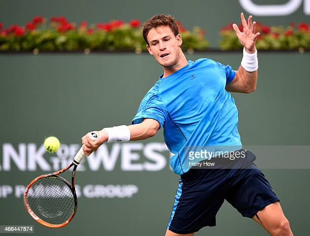 Diego Schwartzman of Argentina hits a forehand in his match against Roger Federer of Switzerland during the BNP Parisbas Open at the Indian Wells...