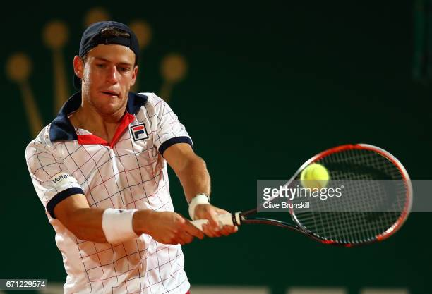 Diego Schwartzman of Argentina plays a backhand against Rafael Nadal of Spain in their quarter final round match on day six of the Monte Carlo Rolex...