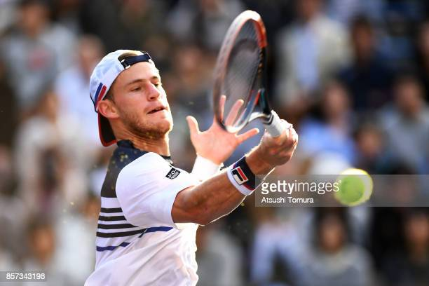 Diego Schwartzman of Argentina plays a forehand against Bernard Tomic of Australia during day three of the Rakuten Open at Ariake Coliseum on October...