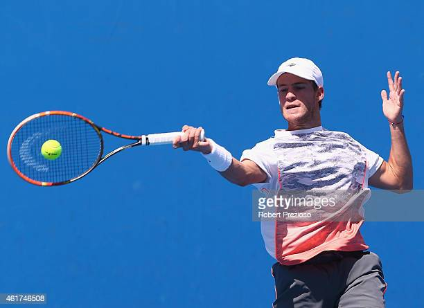 Diego Schwartzman of Argentina plays a forehand in his first round match against Kevin Anderson of South Africa during day one of the 2015 Australian...