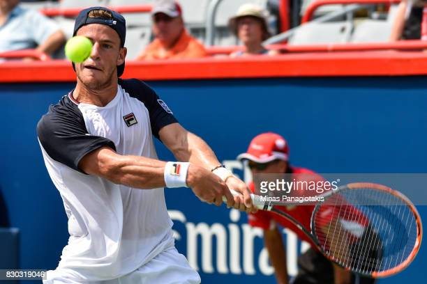 Diego Schwartzman of Argentina prepares to hit a return against Robin Haase of Netherlands during day eight of the Rogers Cup presented by National...