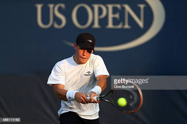 Diego Schwartzman of Argentina returns a shot against Elias Ymer of Sweden during their Men's Singles First Round match on Day One of the 2015 US...
