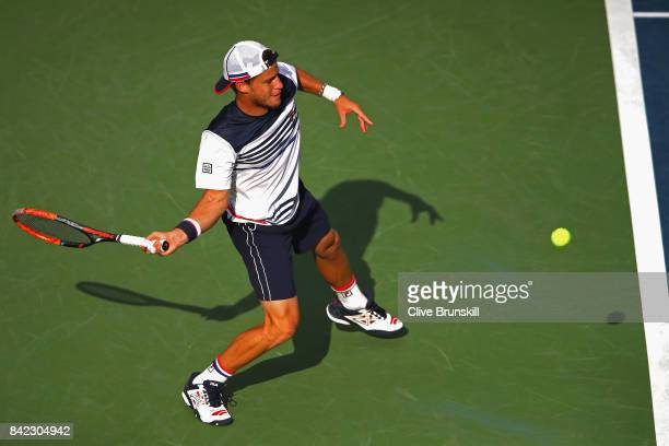 Diego Schwartzman of Argentina returns a shot during his men's singles fourth round match against Lucas Pouille of France on Day Seven of the 2017 US...