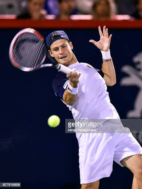 Diego Schwartzman of Argentina returns the ball against Dominic Thiem of Austria during day five of the Rogers Cup presented by National Bank at...