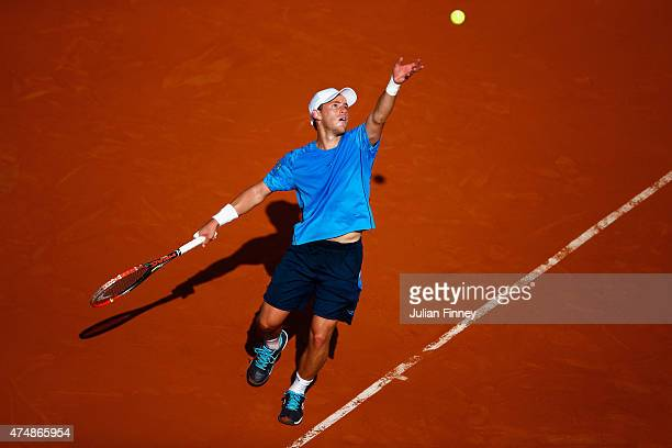 Diego Schwartzman of Argentina serves during the men's singles match against Gael Monfils of France during day four of the 2015 French Open at Roland...