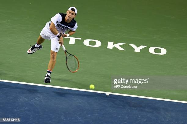 Diego Schwartzman of Argentina serves to David Goffin of Belgium during their men's singles semifinal match of the Japan Open tennis tournament in...