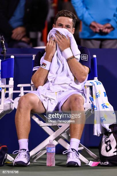 Diego Schwartzman of Argentina wipes himself down in between sets against Dominic Thiem of Austria during day five of the Rogers Cup presented by...