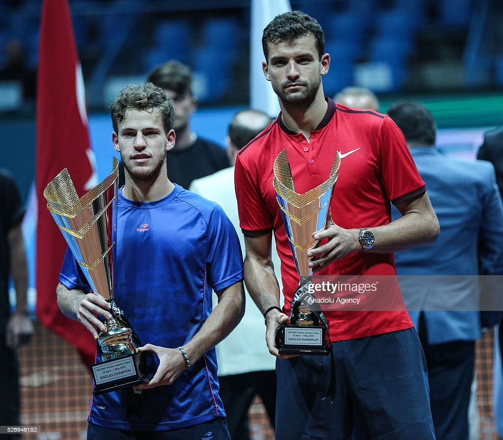 Diego Scwartzman (L) of Argentina and Grigor Dimitrov (R) of Bulgaria pose for a photograph with their trophies at the end of the men's single match between Grigor Dimitrov of Bulgaria and Diego Scwartzman of Argentina at the TEB BNP Paribas Istanbul Open tennis tournament at Koza World of Sports Arena in Istanbul, Turkey on May 01., 2016.