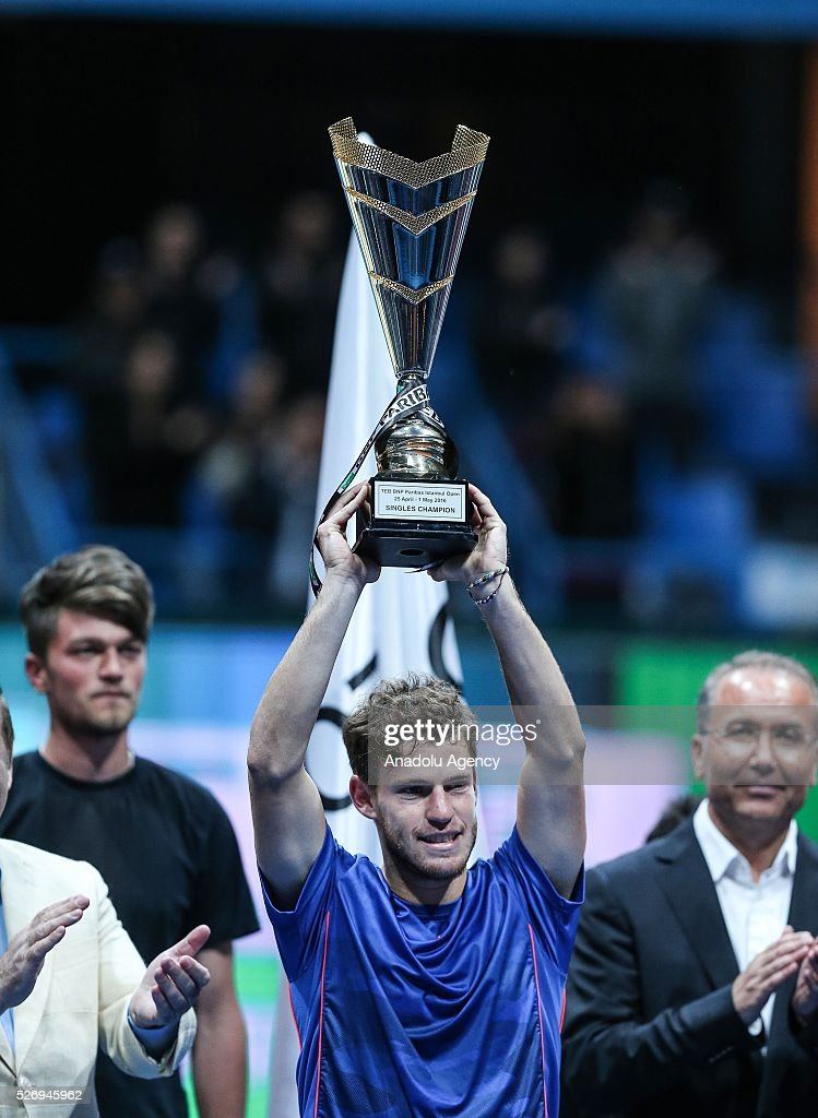 Diego Scwartzman (C) of Argentina poses for a photograph with his trophy after winning the men's single match against Grigor Dimitrov of Bualgaria at the TEB BNP Paribas Istanbul Open tennis tournament at Koza World of Sports Arena in Istanbul, Turkey on May 01, 2016.