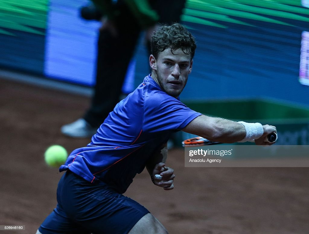 Diego Scwartzman of Argentina returns the ball to Grigor Dimitrov of Bulgaria during the men's single match between Grigor Dimitrov and Diego Scwartzman at the TEB BNP Paribas Istanbul Open tennis tournament at Koza World of Sports Arena in Istanbul, Turkey on May 01, 2016.