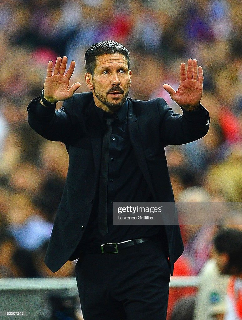 Diego Simeone, Coach of Club Atletico de Madrid gives instructions during the UEFA Champions League Quarter Final second leg match between Club Atletico de Madrid and FC Barcelona at Vicente Calderon Stadium on April 9, 2014 in Madrid, Spain.