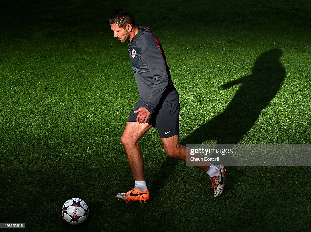 <a gi-track='captionPersonalityLinkClicked' href=/galleries/search?phrase=Diego+Simeone&family=editorial&specificpeople=226872 ng-click='$event.stopPropagation()'>Diego Simeone</a>, Coach of Club Atletico de Madrid on the ball during a Club Atletico de Madrid training session ahead of the UEFA Champions League Final against Real Madrid at Estadio da Luz on May 23, 2014 in Lisbon, Portugal.