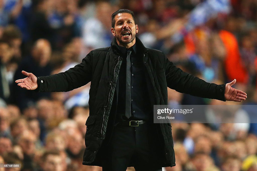 Diego Simeone, coach of Club Atletico de Madrid reacts during the UEFA Champions League semi-final second leg match between Chelsea and Club Atletico de Madrid at Stamford Bridge on April 30, 2014 in London, England.