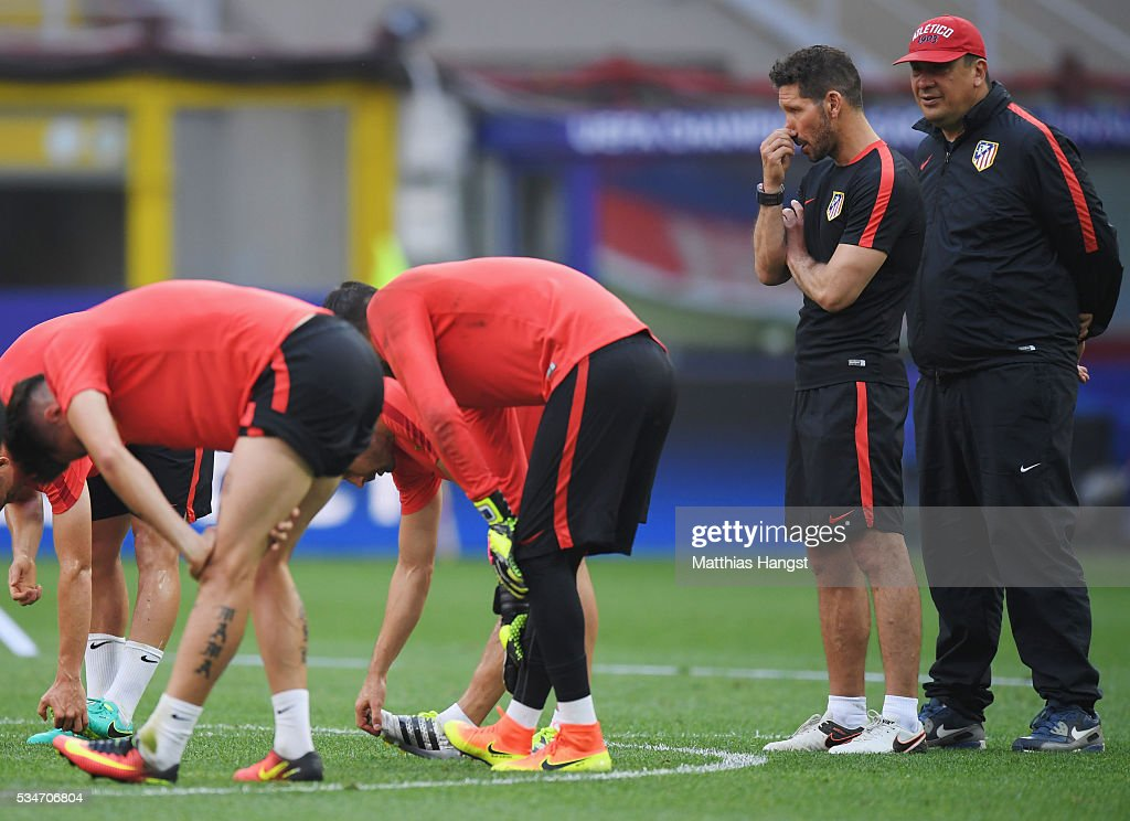 <a gi-track='captionPersonalityLinkClicked' href=/galleries/search?phrase=Diego+Simeone&family=editorial&specificpeople=226872 ng-click='$event.stopPropagation()'>Diego Simeone</a> head coach of Atletico Madrid and his assistant coach <a gi-track='captionPersonalityLinkClicked' href=/galleries/search?phrase=German+Burgos&family=editorial&specificpeople=457900 ng-click='$event.stopPropagation()'>German Burgos</a> look on during an Atletico de Madrid training session on the eve of the UEFA Champions League Final against Real Madrid at Stadio Giuseppe Meazza on May 27, 2016 in Milan, Italy.