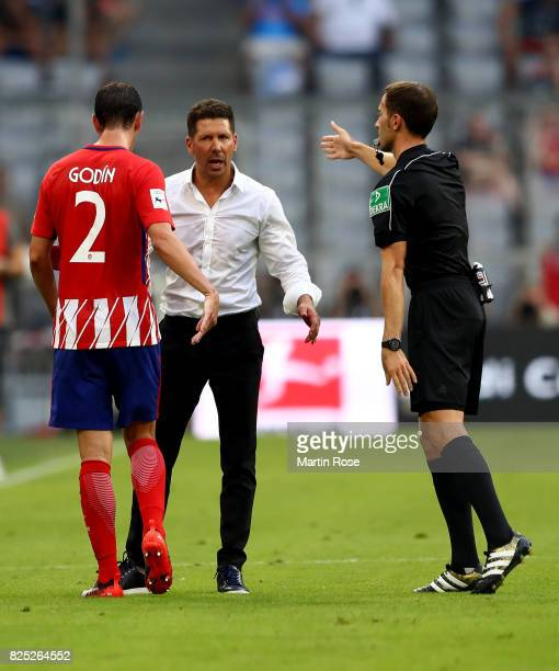 Diego Simeone head coach of Atletico Madrid argues with referee Benjamin Brand uring the Audi Cup 2017 match between Club Atletico de Madrid and SSC...