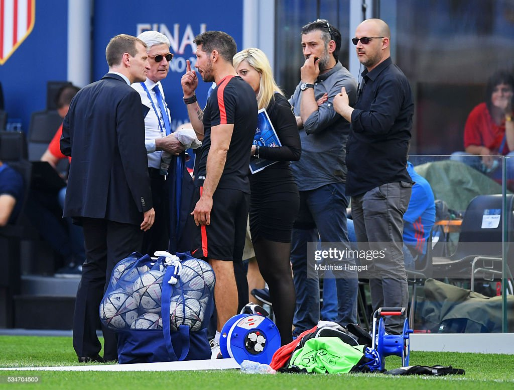 <a gi-track='captionPersonalityLinkClicked' href=/galleries/search?phrase=Diego+Simeone&family=editorial&specificpeople=226872 ng-click='$event.stopPropagation()'>Diego Simeone</a> head coach of Atletico Madrid complains to officials about a TV helicopter overhead during an Atletico de Madrid training session on the eve of the UEFA Champions League Final against Real Madrid at Stadio Giuseppe Meazza on May 27, 2016 in Milan, Italy.