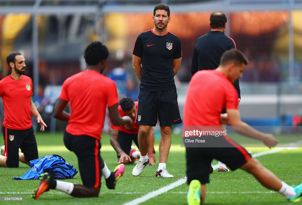 Diego Simeone head coach of Atletico Madrid looks on during an Atletico de Madrid training session on the eve of the UEFA Champions League Final against Real Madrid at Stadio Giuseppe Meazza on May 27, 2016 in Milan, Italy.
