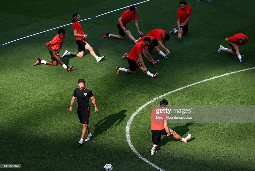 <a gi-track='captionPersonalityLinkClicked' href=/galleries/search?phrase=Diego+Simeone&family=editorial&specificpeople=226872 ng-click='$event.stopPropagation()'>Diego Simeone</a> head coach of Atletico Madrid looks on during an Atletico de Madrid training session on the eve of the UEFA Champions League Final against Real Madrid at Stadio Giuseppe Meazza on May 27, 2016 in Milan, Italy.