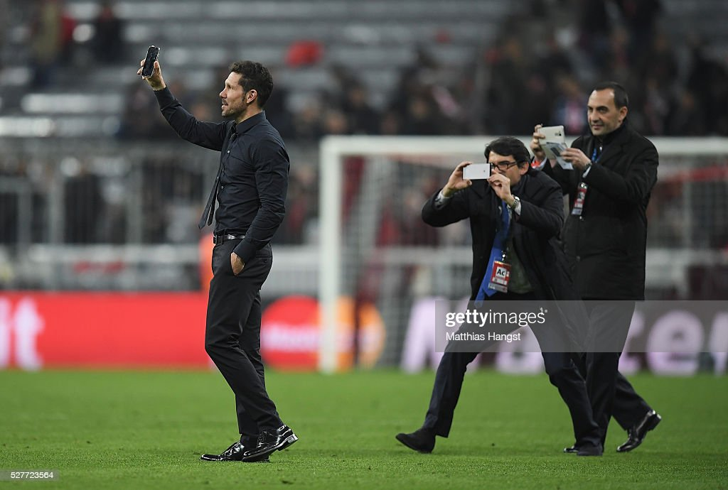 Diego Simeone head coach of Atletico Madrid talks on his mobile phone as he celebrates after the UEFA Champions League semi final second leg match between FC Bayern Muenchen and Club Atletico de Madrid at Allianz Arena on May 3, 2016 in Munich, Germany. Bayern Munich won the match 2-1, but Atletico Madrid reached the final on the away goals rule.