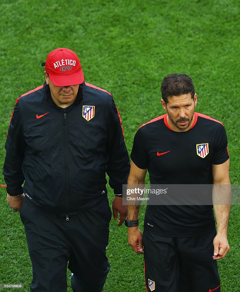 <a gi-track='captionPersonalityLinkClicked' href=/galleries/search?phrase=Diego+Simeone&family=editorial&specificpeople=226872 ng-click='$event.stopPropagation()'>Diego Simeone</a> head coach of Atletico Madrid walks off with his assistant coach <a gi-track='captionPersonalityLinkClicked' href=/galleries/search?phrase=German+Burgos&family=editorial&specificpeople=457900 ng-click='$event.stopPropagation()'>German Burgos</a> after an Atletico de Madrid training session on the eve of the UEFA Champions League Final against Real Madrid at Stadio Giuseppe Meazza on May 27, 2016 in Milan, Italy.
