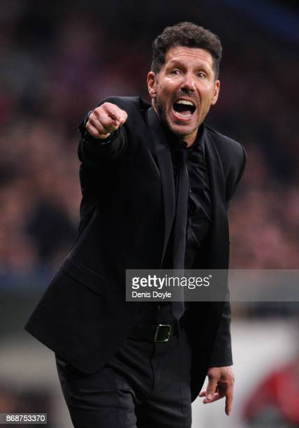 Diego Simeone Manager of Atletico Madrid gives his team instructions during the UEFA Champions League group C match between Atletico Madrid and...