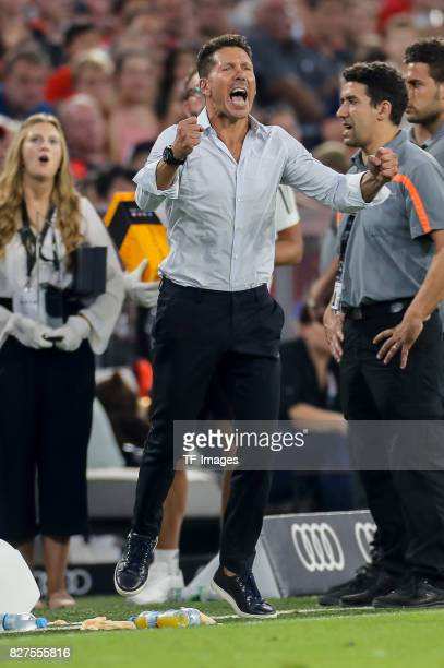 Diego Simeone of Atletico Madrid celebrate their win during the Audi Cup 2017 match between Liverpool FC and Atletico Madrid at Allianz Arena on...