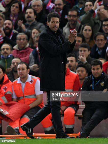 Diego Simeone of Club Atletico de Madrid looks on during the UEFA Champions League Round of 16 second leg match between Club Atletico de Madrid and...