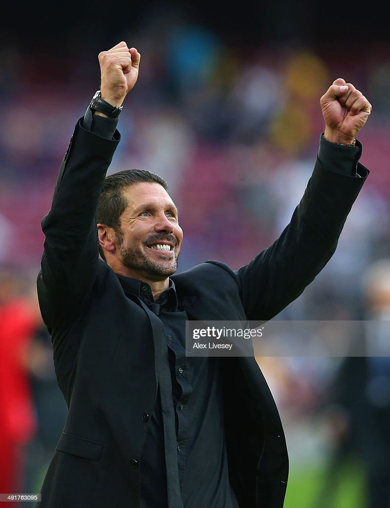 Diego Simeone the coach of Club Atletico de Madrid celebrates towards his supporters after winning the La Liga after the match between FC Barcelona and Club Atletico de Madrid at Camp Nou on May 17, 2014 in Barcelona, Spain.