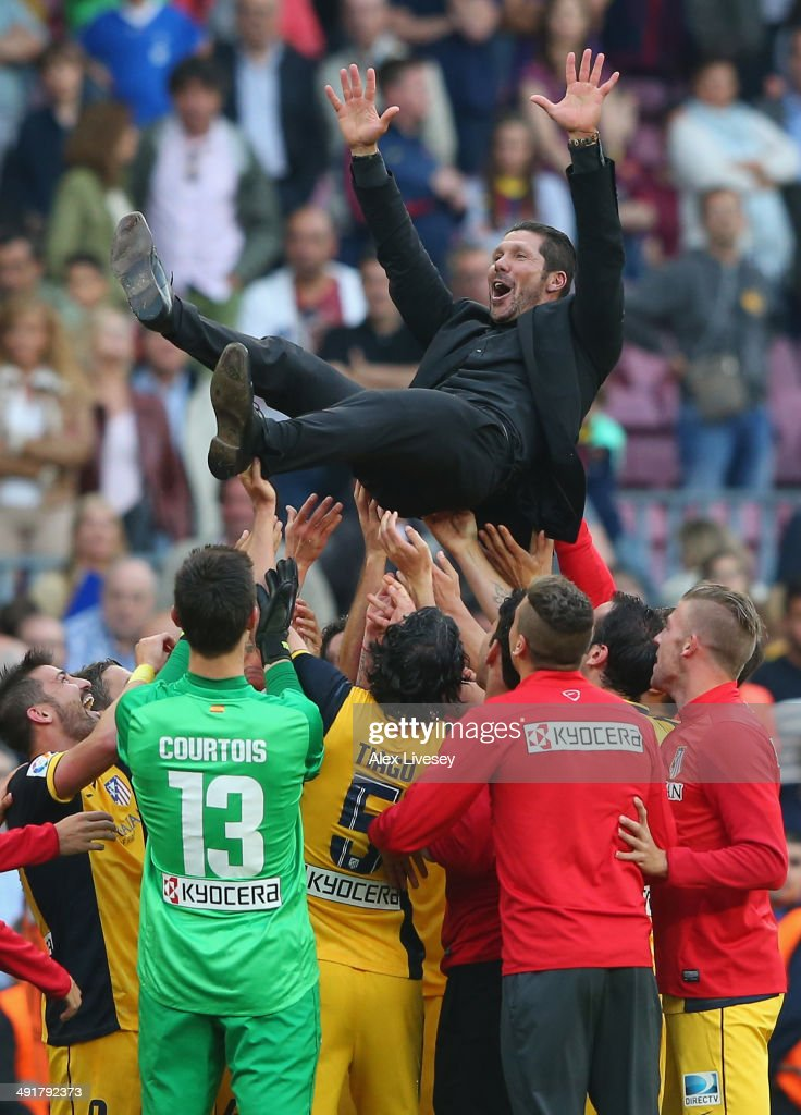 <a gi-track='captionPersonalityLinkClicked' href=/galleries/search?phrase=Diego+Simeone&family=editorial&specificpeople=226872 ng-click='$event.stopPropagation()'>Diego Simeone</a> the coach of Club Atletico de Madrid is thrown in the air by his players after winning the La Liga after the match between FC Barcelona and Club Atletico de Madrid at Camp Nou on May 17, 2014 in Barcelona, Spain.
