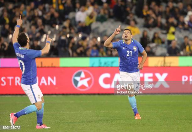 Diego Souza Andrade of Brazil celebrates after scoring a goal during the Brasil Global Tour match between Australian Socceroos and Brazil at...