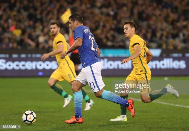Diego Souza Andrade of Brazil runs with the ball during the Brasil Global Tour match between Australian Socceroos and Brazil at Melbourne Cricket...