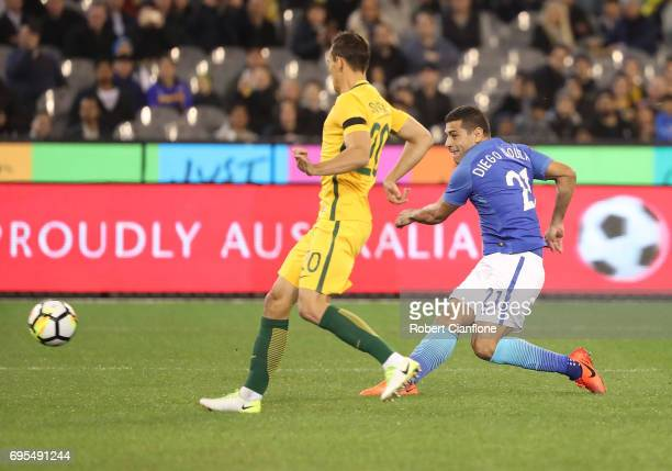 Diego Souza Andrade of brazil shoots on goal to score during the Brasil Global Tour match between Australian Socceroos and Brazil at Melbourne...