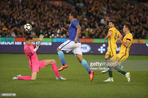 Diego Souza Andrade of Brazil shoots over Australian goalkeeper Mitchell Langerak but is ruled offside during the Brasil Global Tour match between...