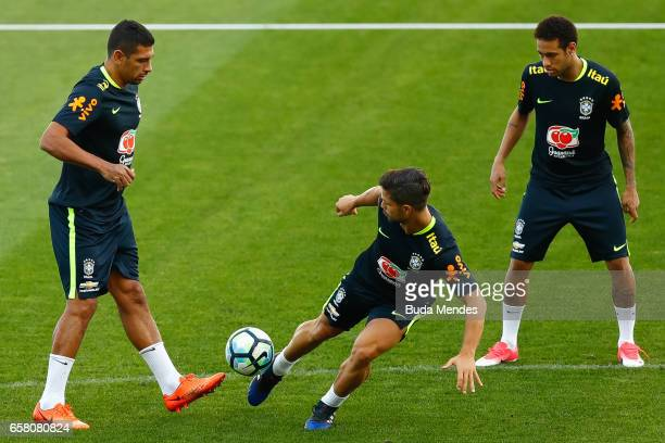 Diego Souza Diego and Neymar of Brazil in action during a training session at Arena Corinthians on March 26 2017 in Sao Paulo Brazil
