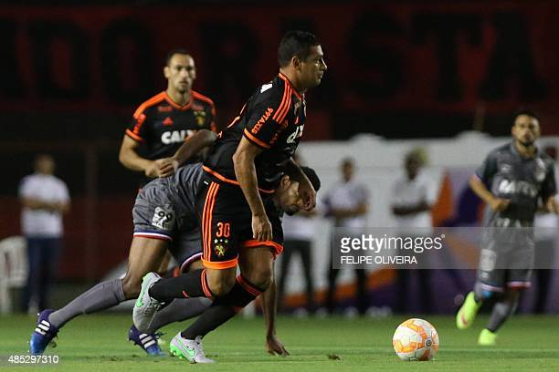 Diego Souza of Brazil's Sport Recife vies for he ball with Jailton of Brazil's Bahia during their Copa Sudamericana football match at the Ilha do...