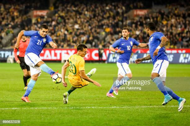 Diego Souza shoots and is blocked by Trent Sainsbury as Brazil plays Australia in the Chevrolet Brasil Global Tour 2017 on June 13 2017 in Melbourne...