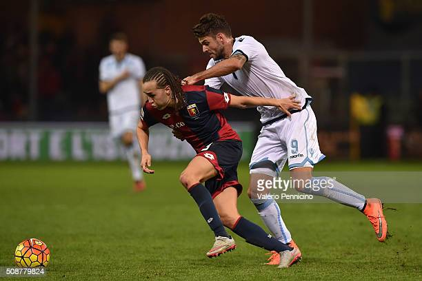 Diego Suarez of Genoa CFC is challenged by Filip Djordjevic of SS Lazio during the Serie A match between Genoa CFC and SS Lazio at Stadio Luigi...