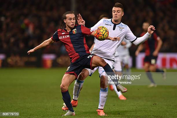Diego Suarez of Genoa CFC is challenged by Sergej Milinkovic of SS Lazio during the Serie A match between Genoa CFC and SS Lazio at Stadio Luigi...