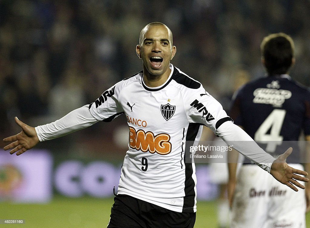 <a gi-track='captionPersonalityLinkClicked' href=/galleries/search?phrase=Diego+Tardelli&family=editorial&specificpeople=805528 ng-click='$event.stopPropagation()'>Diego Tardelli</a> of Atletico Mineiro celebrates a goal during a match between Lanus and Atletico Mineiro as part of Recopa Santander Sudamericana 2014 at Ciudad de Lanus Stadium on July 16, 2014 in Buenos Aires, Argentina.