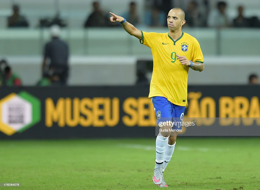 <a gi-track='captionPersonalityLinkClicked' href=/galleries/search?phrase=Diego+Tardelli&family=editorial&specificpeople=805528 ng-click='$event.stopPropagation()'>Diego Tardelli</a> #9 of Brazil celebrates after scoring a goal during the International Friendly Match between Brazil and Mexico at Allianz Parque on June 7, 2015 in Sao Paulo, Brazil.