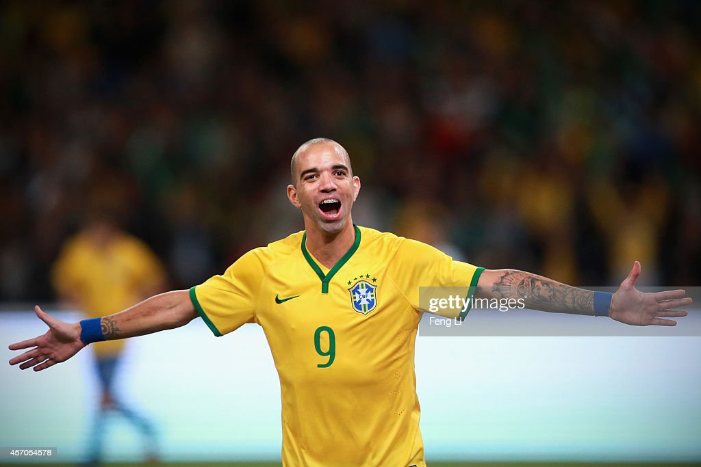 <a gi-track='captionPersonalityLinkClicked' href=/galleries/search?phrase=Diego+Tardelli&family=editorial&specificpeople=805528 ng-click='$event.stopPropagation()'>Diego Tardelli</a> of Brazil celebrates after scoring the second goal during Super Clasico de las Americas between Argentina and Brazil at Beijing National Stadium on October 11, 2014 in Beijing, China.