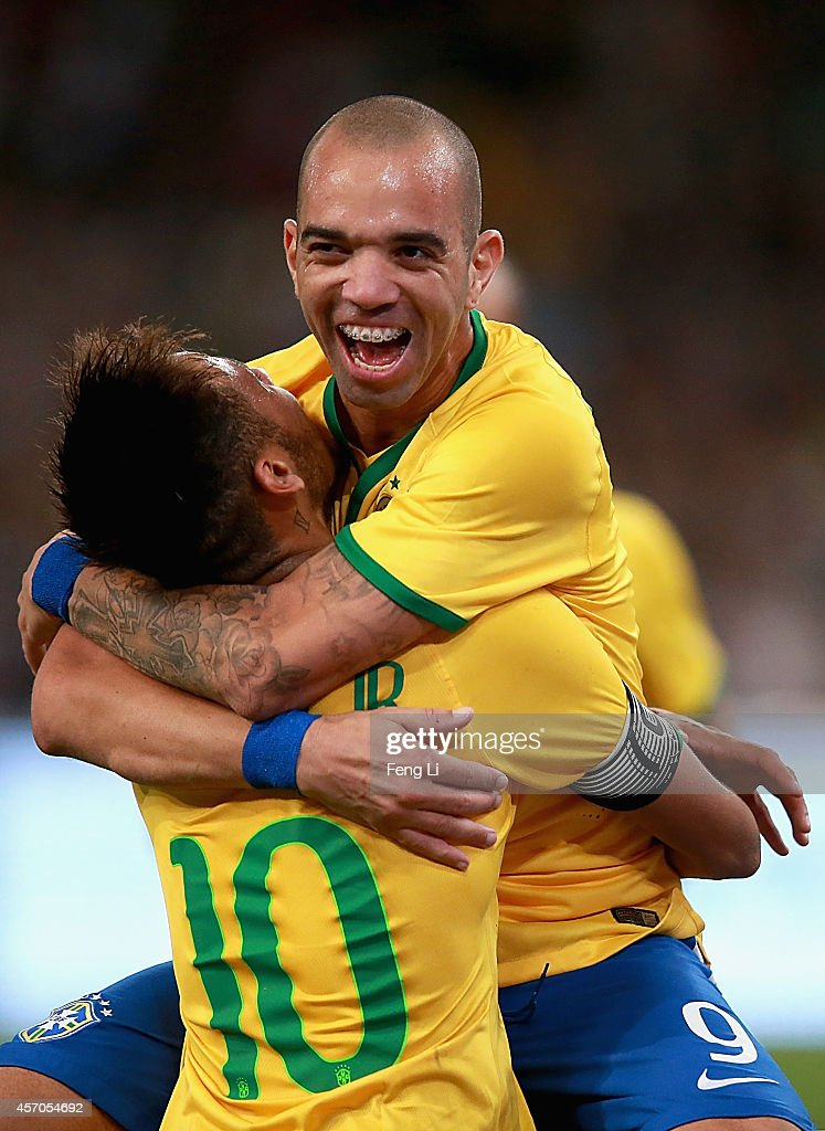 <a gi-track='captionPersonalityLinkClicked' href=/galleries/search?phrase=Diego+Tardelli&family=editorial&specificpeople=805528 ng-click='$event.stopPropagation()'>Diego Tardelli</a> of Brazil celebrates after scoring the second goal with Neymar of Brazil during Super Clasico de las Americas between Argentina and Brazil at Beijing National Stadium on October 11, 2014 in Beijing, China.