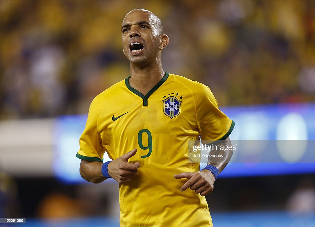 <a gi-track='captionPersonalityLinkClicked' href=/galleries/search?phrase=Diego+Tardelli&family=editorial&specificpeople=805528 ng-click='$event.stopPropagation()'>Diego Tardelli</a> #9 of Brazil reacts during their match against Ecuador at MetLife Stadium on September 9, 2014 in East Rutherford, New Jersey.