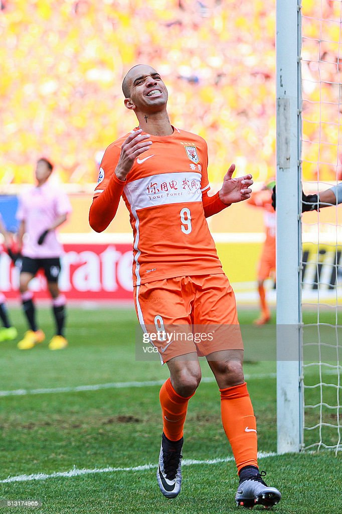 <a gi-track='captionPersonalityLinkClicked' href=/galleries/search?phrase=Diego+Tardelli&family=editorial&specificpeople=805528 ng-click='$event.stopPropagation()'>Diego Tardelli</a> #9 of Shandong Luneng reacts after missing a goal opportunity during the AFC Champions League Group F match between Shandong Luneng and Buriram United at Jinan Olympic Sports Centre on March 1, 2016 in Jinan, China.