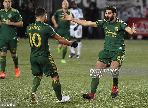 Diego Valeri celebrates with Sebastian Blanco of Portland Timbers after scoring a goal during the second half of the match against the Minnesota...