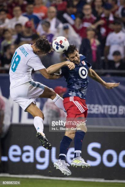 Diego Valeri of the MLS AllStars goes up for the header against Marcos Llorente of Real Madrid during the MLS AllStar match between the MLS AllStars...